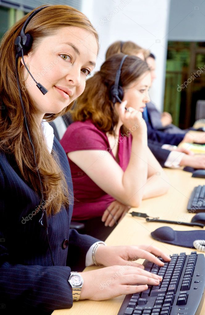 Business team of customer service representatives on their computers — Stock Photo #7568472