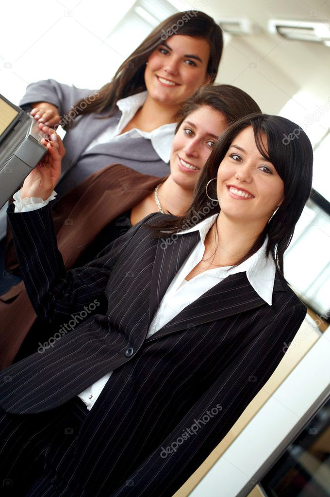 Business female team portrait in an office environment - all looking friendly and smiling — Stock Photo #7568475