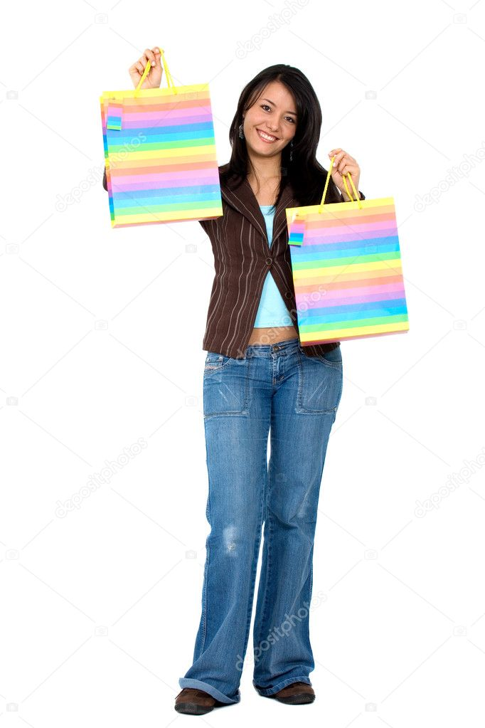 Happy girl smiling holding shopping bags - isolated over a white background — Stock Photo #7568486
