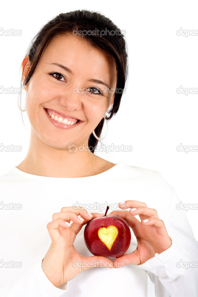 I love my diet - girl holding a red apple with a heart shape on it isolated over a white background  Stock Photo #7568491