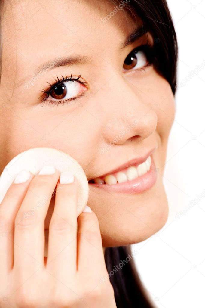 Beauty girl applying powder make up on her face isolated over a white background  Stock Photo #7568509