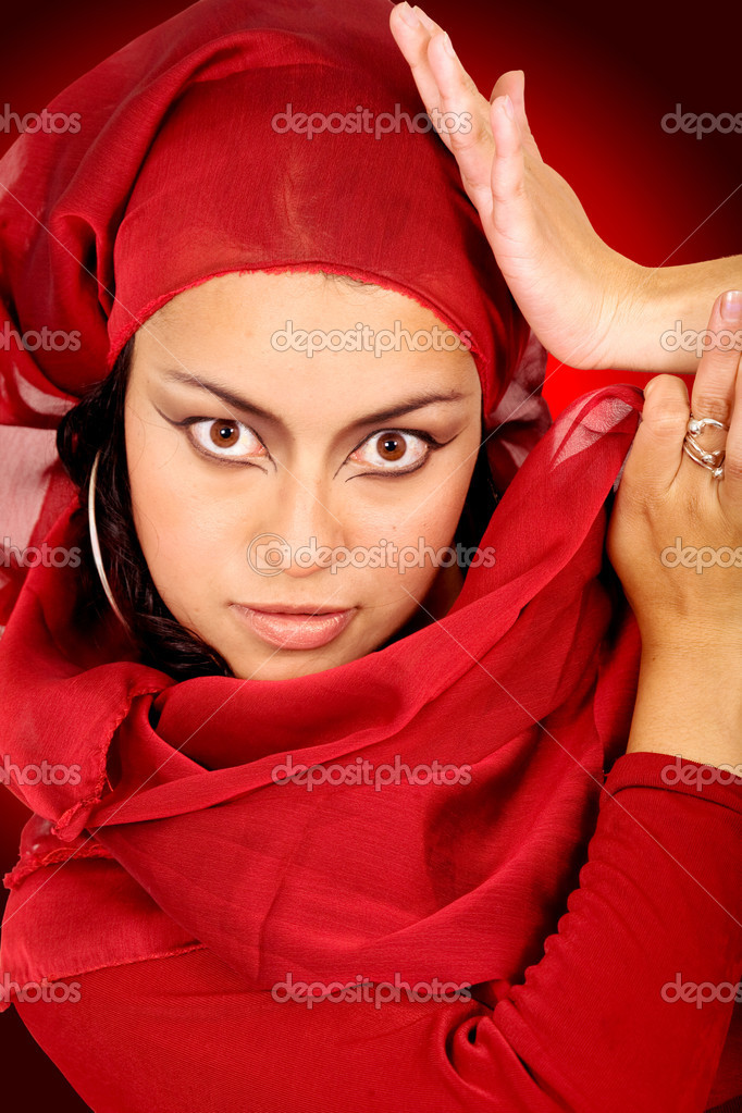 Beautiful arabic belly dancer over a red background — Stock Photo #7568923