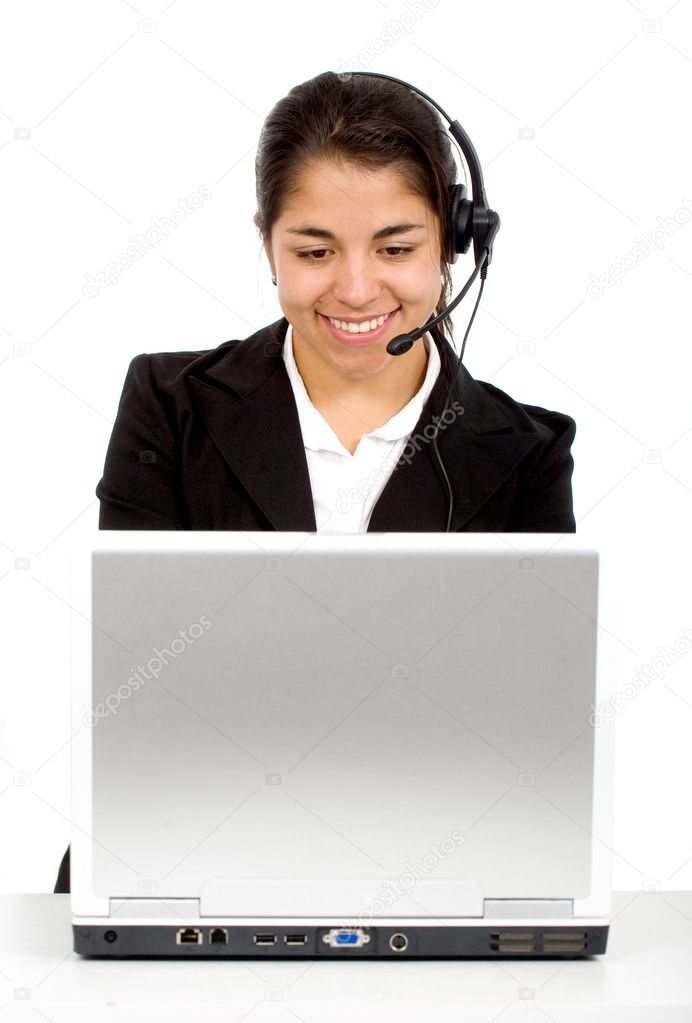 Customer service girl at her desk on a laptop computer smiling - isolated over a white background — Stock Photo #7568961