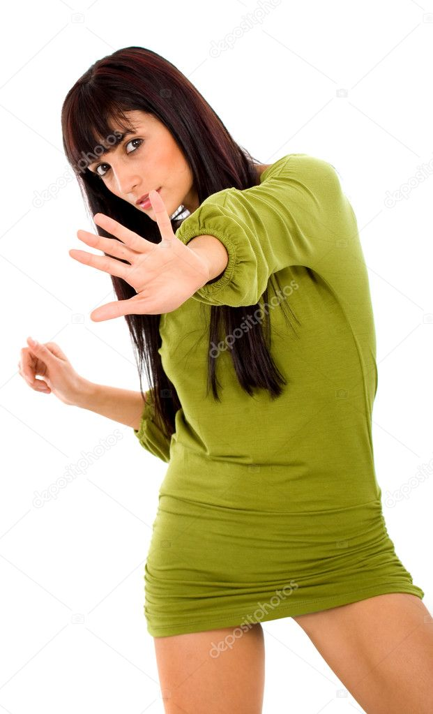 Fashion girl with hand in front of her signalling to stop - isolated over a white background  Stock Photo #7569328