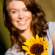 Happy girl with a sunflower — Stock Photo #7598350