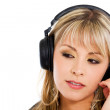 Blond girl listening to music — Stock Photo
