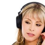 Blond girl listening to music — Stock Photo