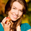 Beautiful girl portrait with an apple — Stock Photo