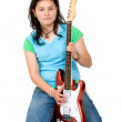 Girl with aan electric guitar — Stockfoto