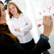 Royalty-Free Stock Photo: Female teacher on a maths lesson