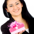 Business woman with a gift — Stock Photo