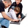 Parents and kid on a laptop — Stock Photo