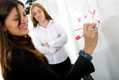 Female teacher on a maths lesson — Stock Photo