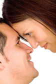 Beautiful couple facing each other — Stock Photo