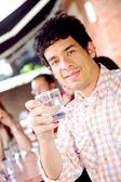 Chlap v cafee s drink — Stock fotografie
