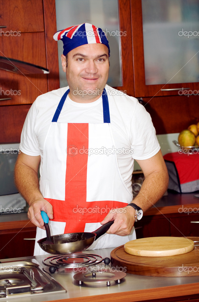 Chef in his kitchen at home smiling — Stock Photo #7598661