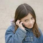 Girl talking on mobile — Stock Photo