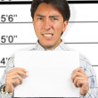 Angry business male mugshot - Stock Photo