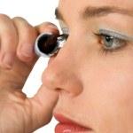 Applying mascara over white — Stock Photo #7632951