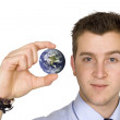 Business man holding globe — Stock Photo #7632993