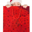 Beautiful girl coming out of christmas bag — Stock Photo #7633057