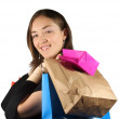 Shopping girl with bags smiling at camera — Stok fotoğraf