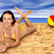 Ball and girl at the beach — Stock Photo #7633104