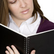 Student reading - focus on notebook — Stock Photo