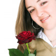Beautiful girl holding a rose — Stock Photo #7633180