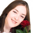 Stock Photo: Beautiful girl with rose smiling