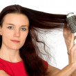Beautiful female model combing her hair — Stock Photo #7633193