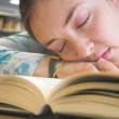 Beautiful student sleeping on the library — Stock Photo