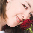Beautiful girl face with rose - Stock Photo