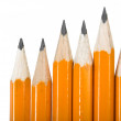 Black pencils over white — Stock Photo
