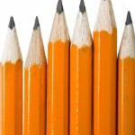 Black pencils over white — Stock Photo