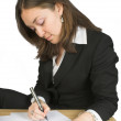 Stock Photo: Business womsigning papers