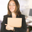 Business woman in her office holding a folder — Stock Photo #7633489