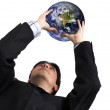 Business man with globe over white - Stockfoto
