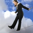 Business woman balancing on rope — Stock Photo #7633527
