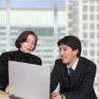 Business couple with laptop in the office — Stock Photo #7633612
