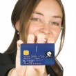 Stock Photo: Business womholding credit card up