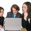 Business female team with laptop - Stock Photo