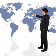 Business man presenting a world map — 图库照片