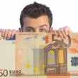 Business man appearing on euro note - Stock Photo