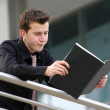 Stock Photo: Business mbored - reading aris