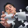 Business man arranging puzzle - Lizenzfreies Foto