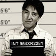 B & W mugshot of business man - Stock Photo