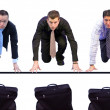 Stock Photo: Three business men having a race for their briefcases