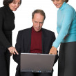 Business management team with laptop — Stock Photo