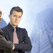 Business men looking confident - world background — Stock Photo #7633934